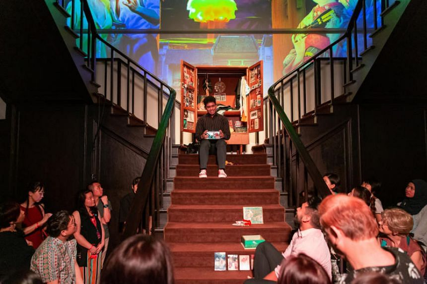 """Partygoers wandered from room to room in the Arts House at the 22nd Singapore Writers Festival, discovering acts such as a """"silent disco"""" to a Portuguese-Malaccan folk song."""