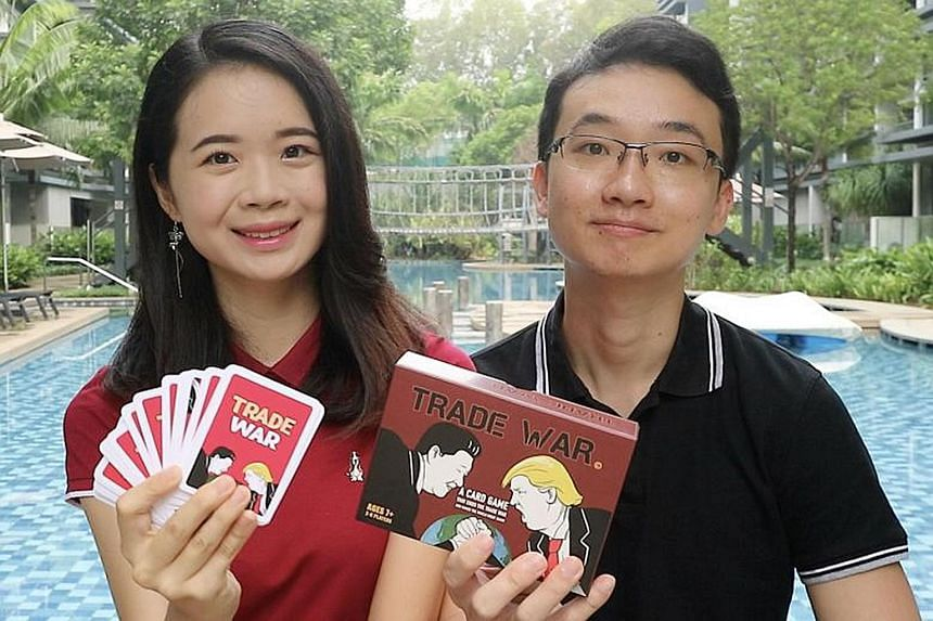 Ms Lai Yi Xuan and Dr Lin Zhiyong with the Trade War Card Game they created to make the US-China trade war easier to understand and more relatable to people. The couple plan to launch the game on crowdfunding platform Kickstarter next Tuesday.