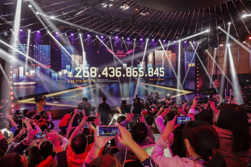 Alibaba logged more than 268 billion yuan ($52 billion) of purchases during its Singles' Day bonanza, exceeding last year's record haul after a 24-hour shopping marathon.