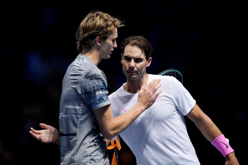Germany's Alexander Zverev (left) with Spain's Rafael Nadal after winning their group stage match at The O2, London, Britain on Nov 11, 2019.