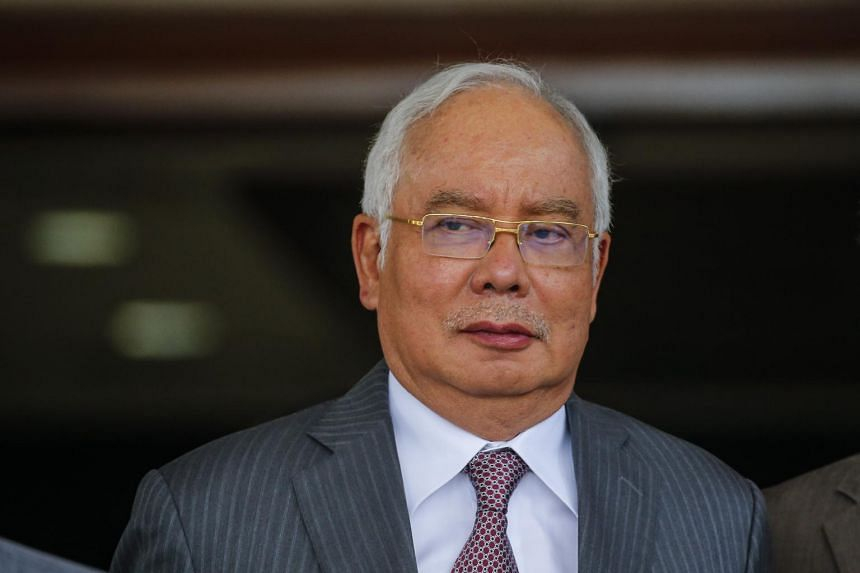 A picture taken on Oct 29, 2019, showing former Malaysian prime minister Najib Razak leaving the Kuala Lumpur High Court complex.