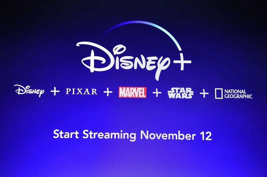 A screen announcing the Disney+ streaming service is seen at the D23 Expo in Anaheim, California.