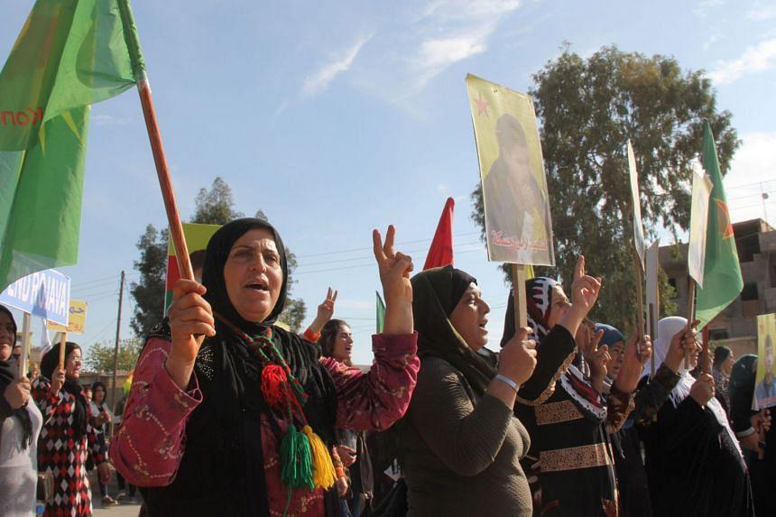 Syrian Kurdish protesters demonstrate against Turkish threats in Qamishli, the de-facto capital of Syria's embattled Kurdish minority, on Nov 12, 2019.
