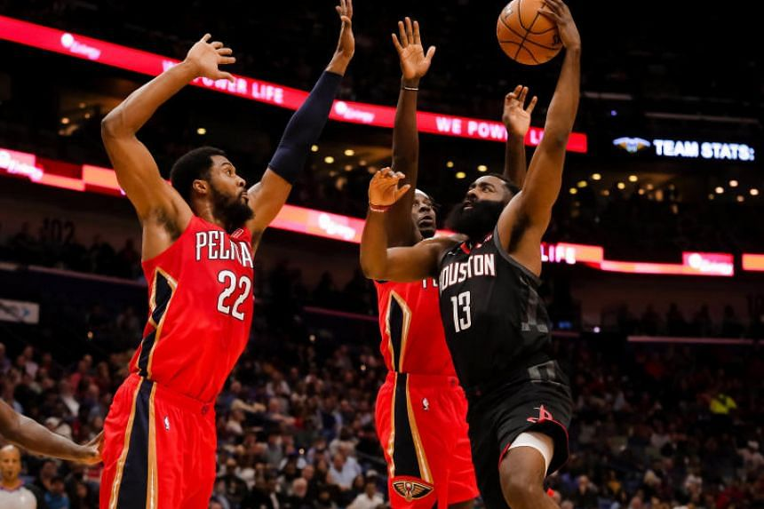 James Harden (in black) scored 13 straight points as the Houston Rockets took command midway through the fourth quarter during the game against the New Orleans Pelicans.
