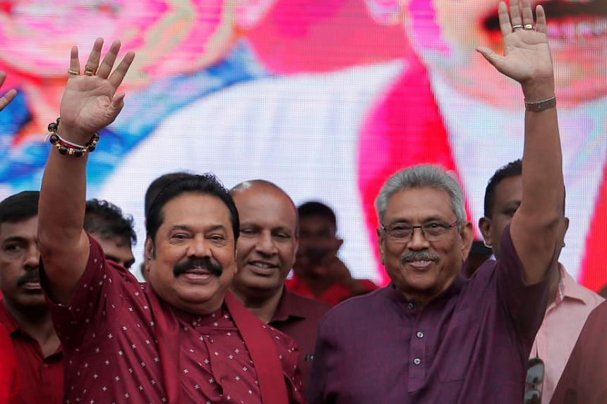 In a photo from Oct 13, 2019, former defence secretary Gotabhaya Rajapaksa (right) and his brother, former president Mahinda Rajapaksa, wave at supporters during an election campaign rally in Sri Lanka.