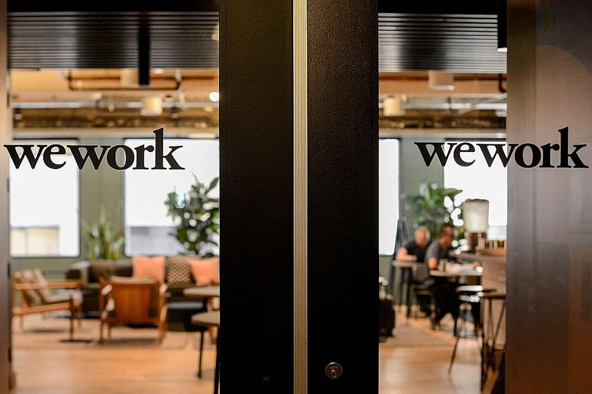 After rapidly expanding its network of office spaces, WeWork was close to running out of money when it got a bailout last month from SoftBank, the Japanese conglomerate that is the firm's largest outside shareholder. PHOTO: REUTERS