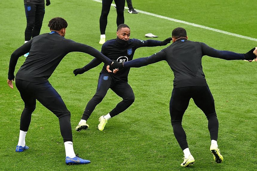 Left: Manchester City striker Raheem Sterling (centre) has been dropped from England's Euro 2020 qualifier against Montenegro tomorrow after he and Liverpool defender Joe Gomez clashed during their training camp on Monday. Below: Joe Gomez, who also