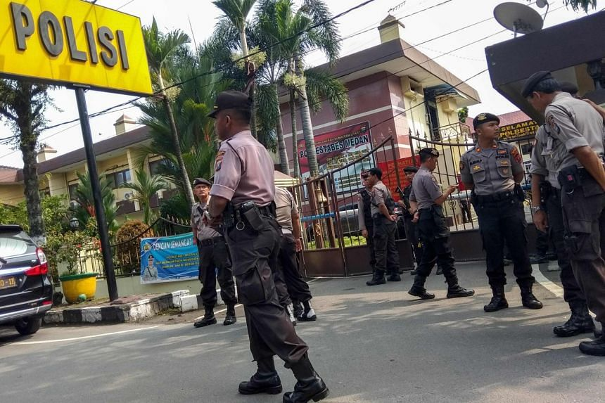 Police officers secure their headquarters in Medan, North Sumatra, on Nov 13, 2019, after a suicide attack occurred during their morning roll call.