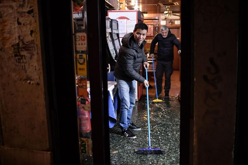 Shopkeepers clear their premises on Nov 12, 2019, in Venice.