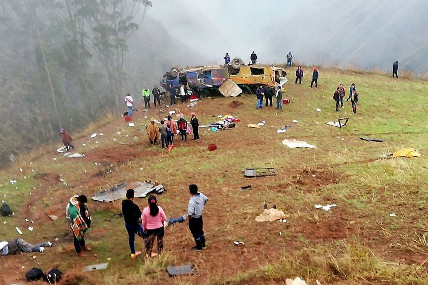 The scene after a bus fell from a precipice in Otuzco, northern Peru.