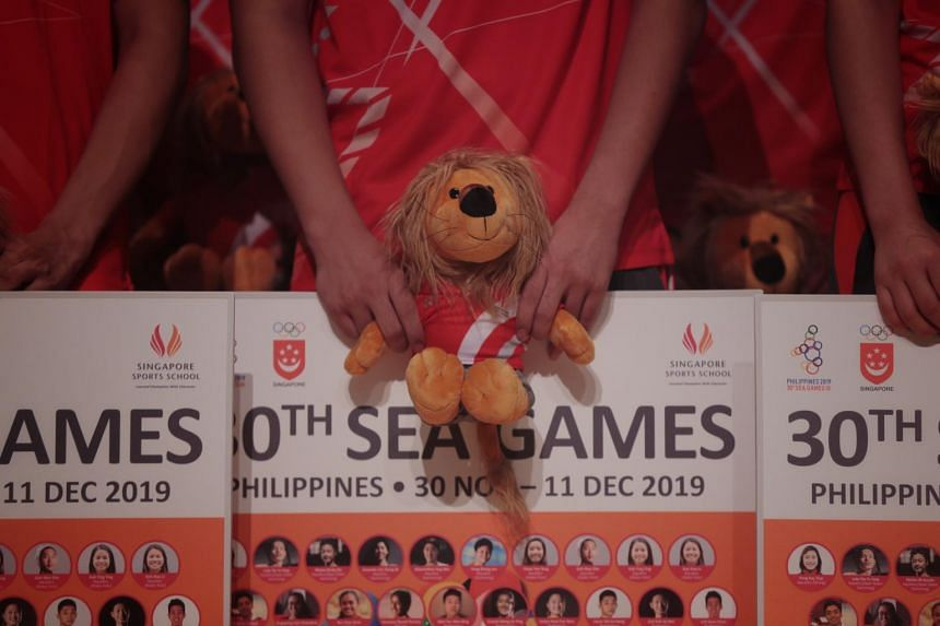 An athlete holds a stuffed animal during the Singapore Sports School send-off for students competing at the SEA Games on Nov 6, 2019.