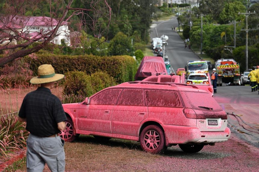 A car sprayed with fire retardant is seen after a bush fire in the residential area of Sydney, on Nov 12, 2019.