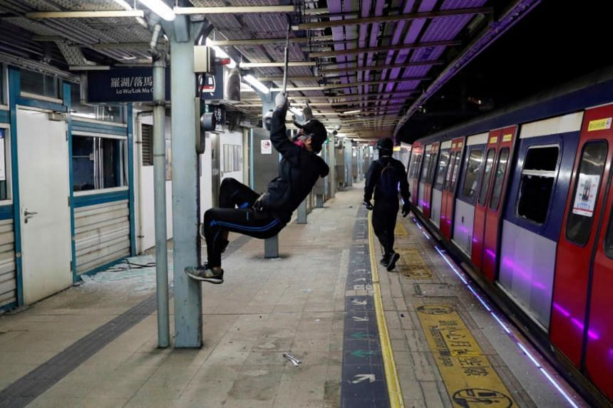 Anti-government protesters vandalise the University MTR station during a protest at the Chinese University of Hong Kong, on Nov 13, 2019.