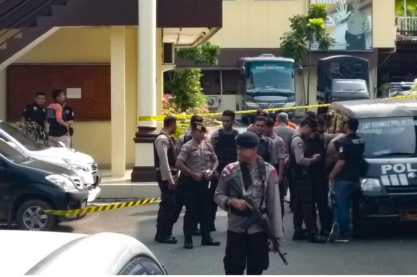 Police officers secure their headquarters in Medan, North Sumatra, on Nov 13, 2019, after a suicide attack occured during their morning roll call.
