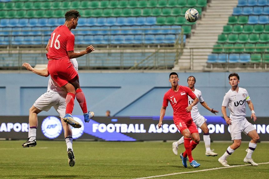 Singapore Under-22 captain Irfan Fandi heading home a goal in the 4-1 friendly win over Perth Glory's U-20 team during their match at the Jalan Besar Stadium last night. ST PHOTO: KEVIN LIM
