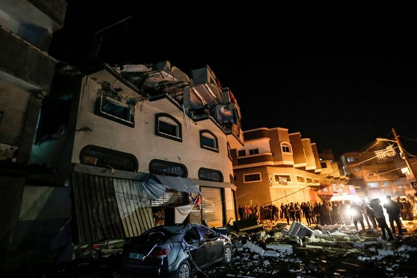 Palestinians inspect the damaged house of Islamic Jihad leader Baha Abu Al-Ata afther an Israeli attack in Gaza city, on Nov 12, 2019.