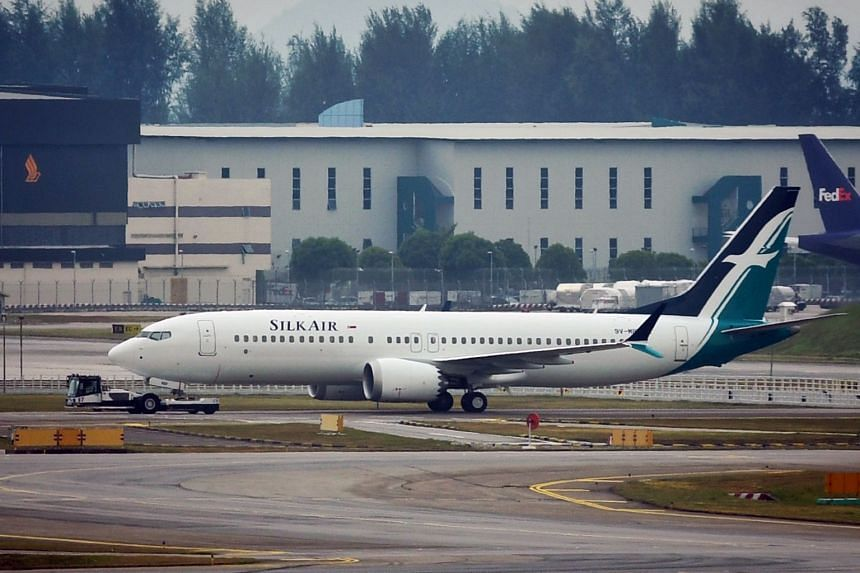In a photo from March 12, 2019, a SilkAir Boeing 737 Max 8 plane sits on the tarmac at Changi Airport.
