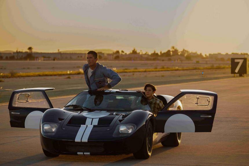 Movie still from Ford V. Ferrari starring Christian Bale (left).