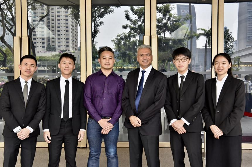 Mr Bryan Choong Chee Hong (in purple) with his lawyers, (from left) Mr Jordan Tan, Mr Remy Choo Zheng Xi, and Senior Counsel Harpreet Singh Nehal, who are assisted by Mr Wong Thai Yong and Ms Priscilla Chia Wen Qi.