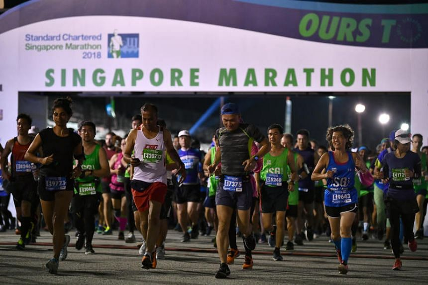 Participants starting their run after the flag off during the Standard Chartered Singapore Marathon 2018.