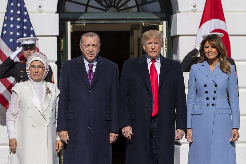 Trump (second right) and First Lady Melania Trump (far right) greet Turkish President Recep Tayyip Erdogan and his wife Emine Erdogan.