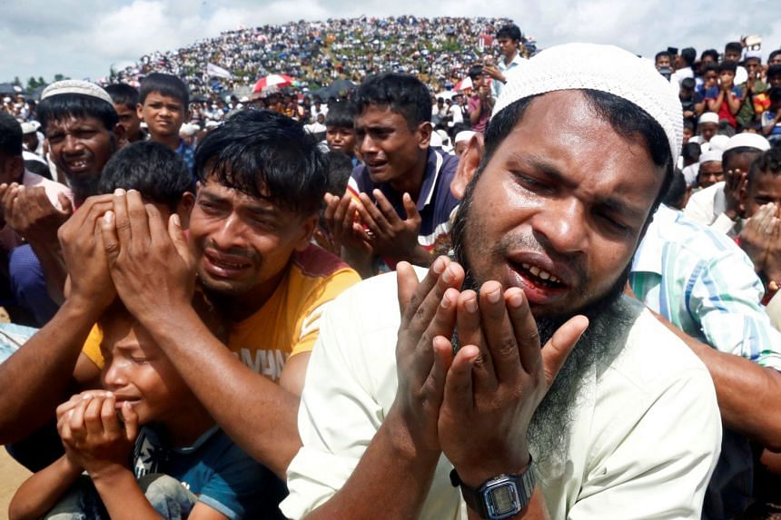 Rohingya refugees pray at a gathering in August 2019 to mark the second anniversary of their exodus from Myanmar.