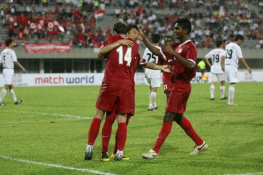 Singapore fans go wild after Harris Harun scores one of his two goals against Myanmar in their AFF Suzuki Cup game at the National Stadium on Nov 26, 2014. Hariss Harun looking sharp during national team training in 2017. He will be the 13th Lion to