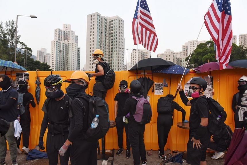 Protesters standing next to barricades at Hong Kong Baptist University in Kowloon Tong area, in Hong Kong, on Nov 13, 2019. Meanwhile, US senators are doubling their efforts to push for a vote on the Hong Kong Human Rights and Democracy Act.