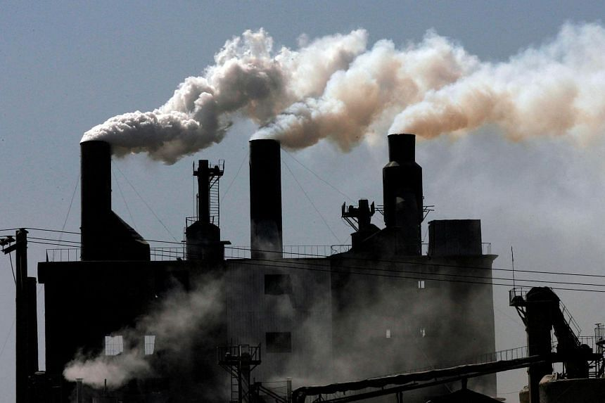 Smoke billows from a factory on the outskirts of Shenyang, northeast China's Liaoning province.