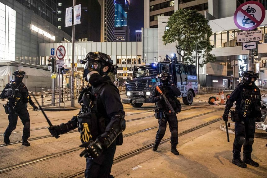 Riot police securing a road after clearing protesters in the Central district in Hong Kong, on Nov 13, 2019.
