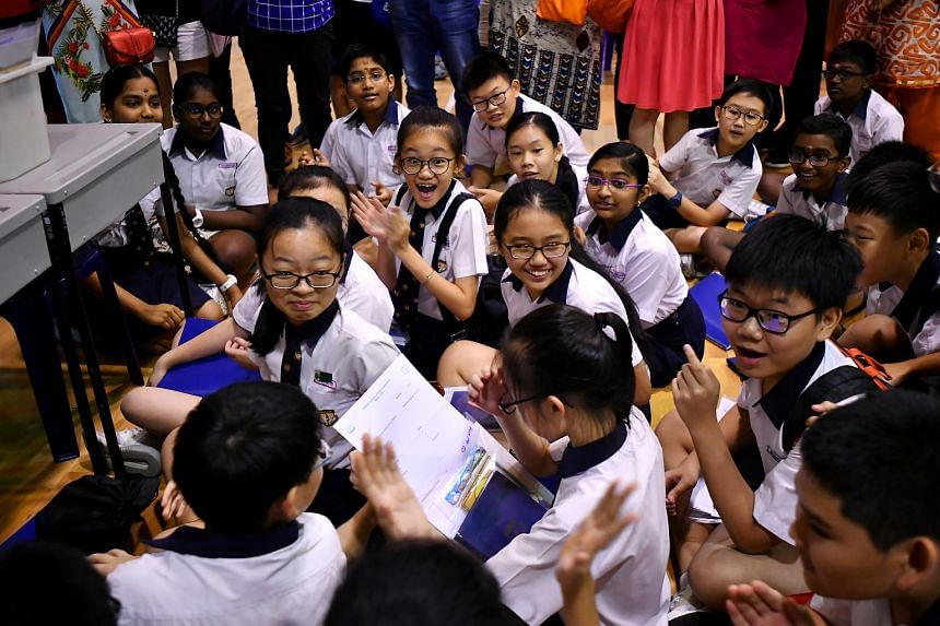In a photo taken on Nov 22, 2018, Geylang Methodist School (Primary) pupils react after receiving their PSLE results.