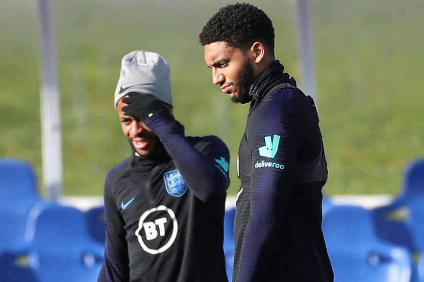 Left: Raheem Sterling and Joe Gomez during training yesterday ahead of England's Euro 2020 qualifier against Montenegro today. Although Sterling has been dropped for the game, he remains with the squad and could feature against Kosovo on Sunday. Belo