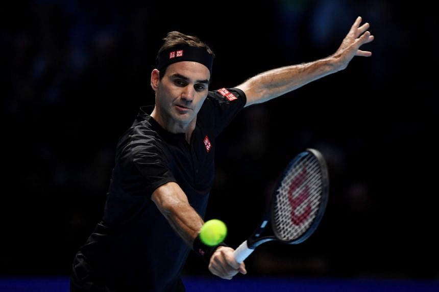 Switzerland's Roger Federer in action during his group stage match against Serbia's Novak Djokovic.