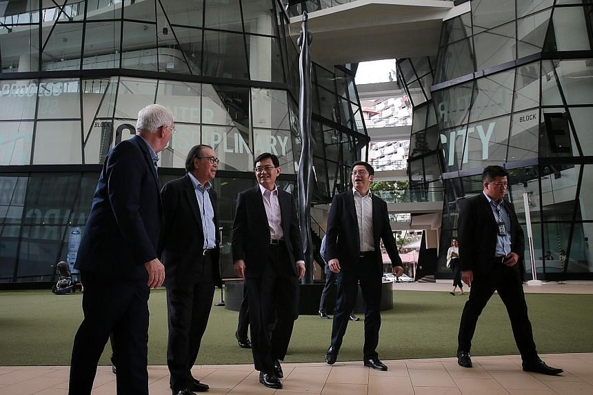 Deputy Prime Minister Heng Swee Keat (third from left) at the Lasalle College of the Arts' McNally Street campus yesterday with (from left) school president Steve Dixon; Lasalle chairman Peter Seah; and Ngee Ann Kongsi president Jamie Teo. While the