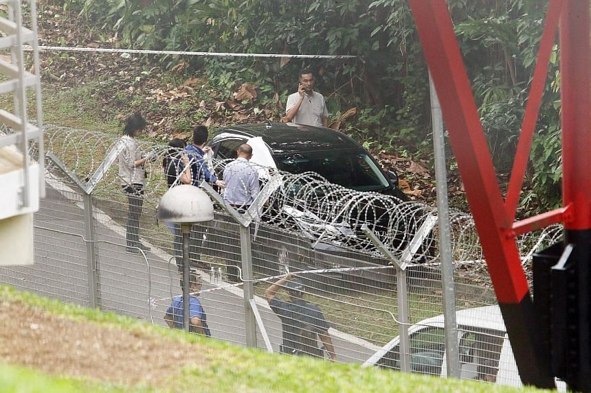 The police said they were alerted to the two cases along Lorong Sesuai at 6.42am. The boy, five, was found motionless in a car while the woman, 41, was found lying motionless nearby. PHOTO: SHIN MIN DAILY NEWS
