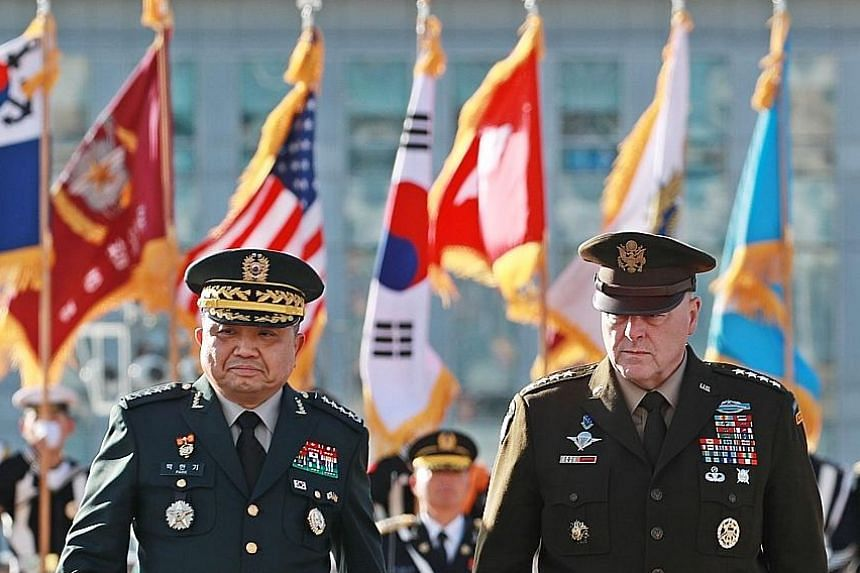 General Park Han-ki, chairman of South Korea's Joint Chiefs of Staff, with his United States counterpart, General Mark Milley, during a welcome ceremony in Seoul yesterday. Senior US defence officials are gathering in Seoul for annual meetings. PHOTO