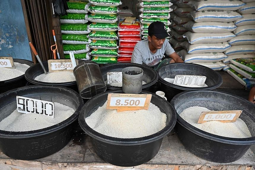 Rice has been woven into the culinary fabric of Indonesians, whose former president Suharto transformed it into a must-have meal. Indonesians now gobble down rice at a rate almost three times the global average of 53kg annually. PHOTO: AGENCE FRANCE-