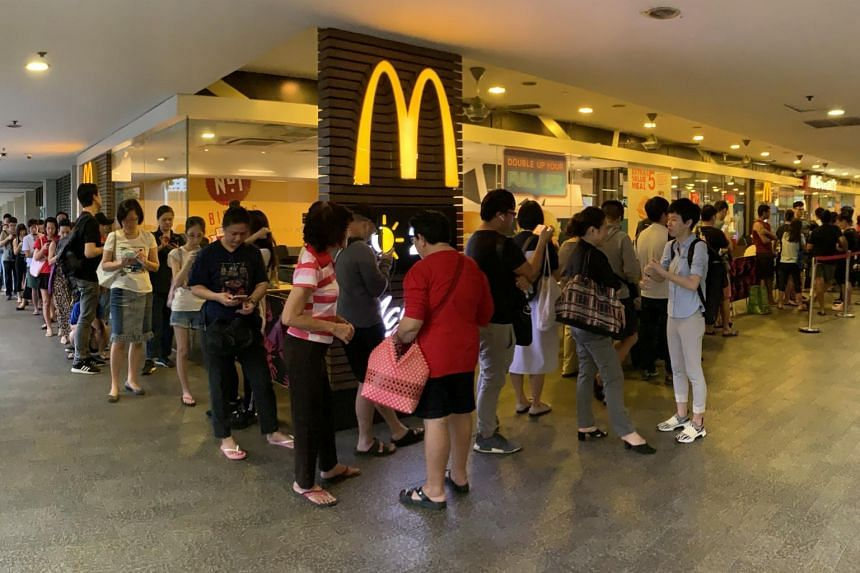 The snaking queue at Causeway Point McDonald's following the launch of the limited-edition Hello Kitty carrier on Nov 14, 2019.