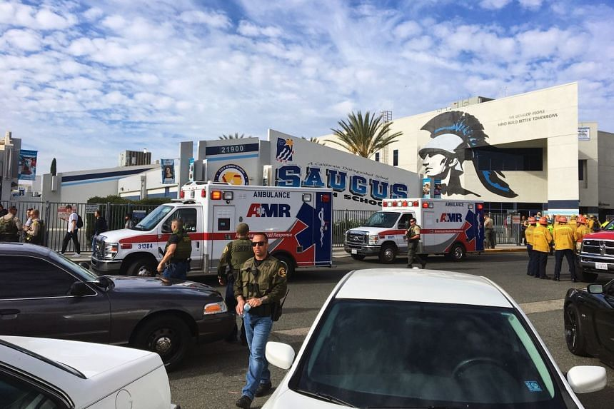 Law enforcement and emergency personnel respond to a shooting at Saugus High School.