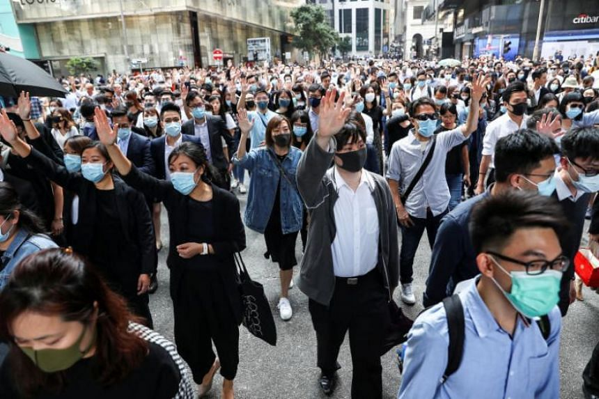 Protesters in Hong Kong's Central district on Nov 14, 2019. Executives at a number of firms expressed a heightened level of caution this week after skirmishes repeatedly erupted in the streets during work hours this week.