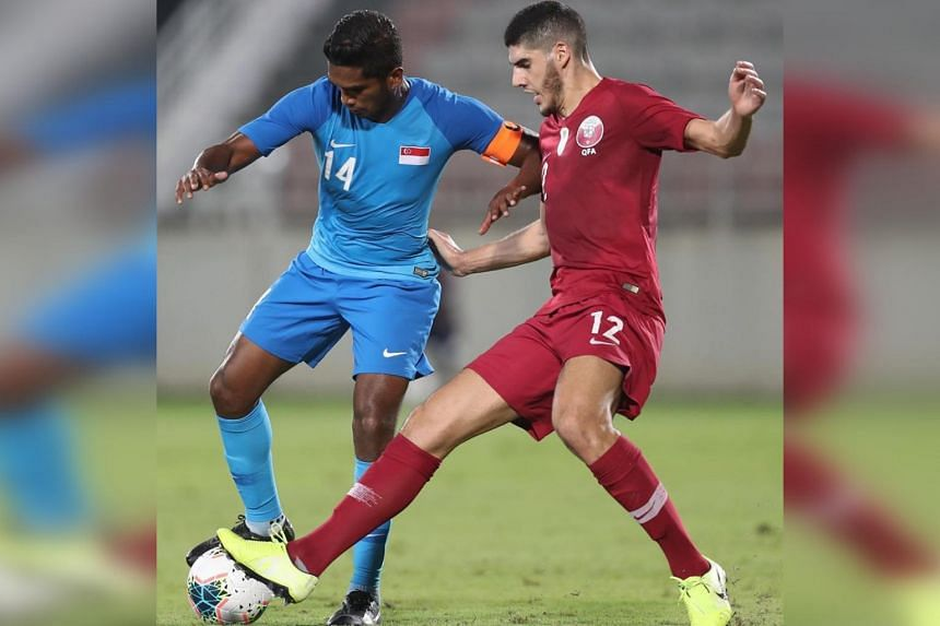 Singapore captain Hariss Harun (left), who earned his 100th cap, in action against Asian champions Qatar on Nov 14, 2019.