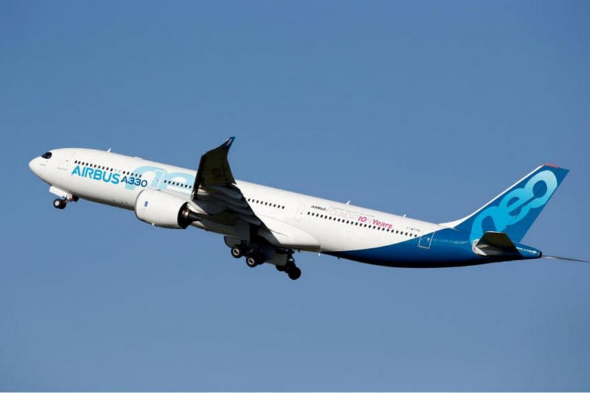 A photo taken on March 20 shows an Airbus A330neo taking off from the Airbus delivery centre in Colomiers, France.