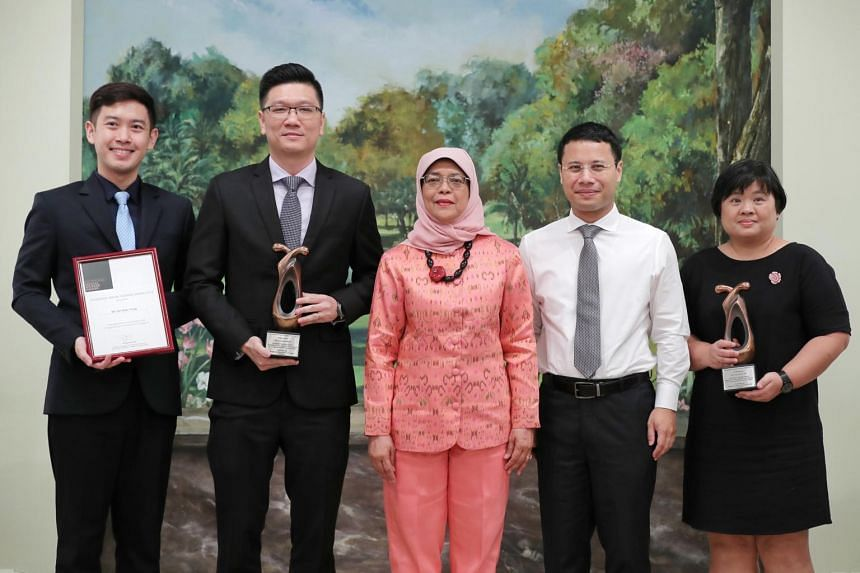 President Halimah Yacob and Minister for Social and Family Development and Second Minister for National Development Desmond Lee with Promising Social Worker award recipient Lim Shen Yong (left), and Outstanding Social Worker Award recipients Lee Seng