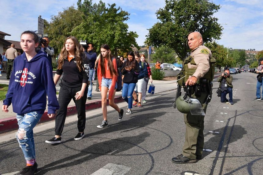 Students line up after a shooting at Saugus High School in Santa Clarita, California.