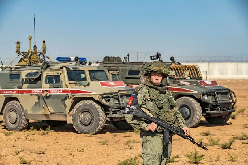 Russian military police take part in a joint Turkish-Russian army patrol near the town of Darbasiyah in northeastern Syria on Nov 11, 2019.