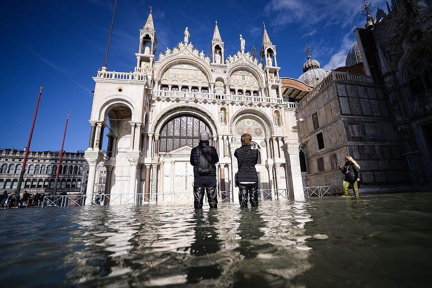The flooded St Mark's Square, including St Mark's Basilica (centre), on Thursday in Venice. Much of Venice was left underwater after the highest tide in 50 years ripped through the historic Italian city, beaching gondolas, trashing hotels and sending