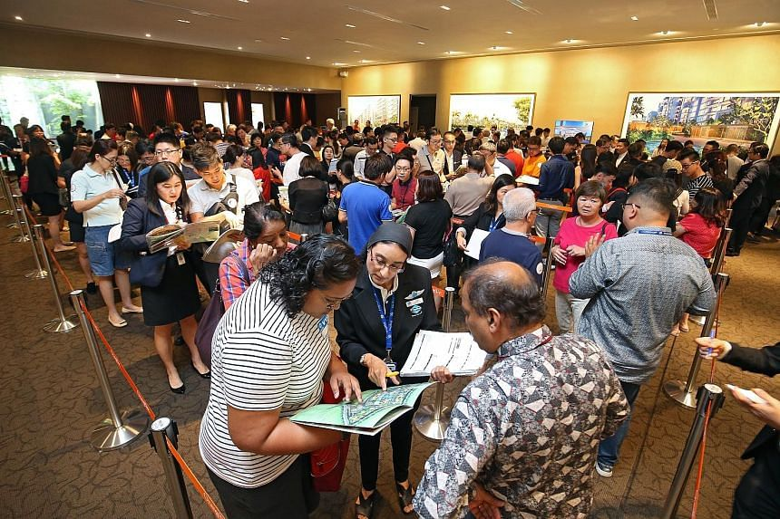 Prospective buyers at the launch of Treasure at Tampines in March. The proportion of new private home sales attributable to the suburbs or outside central region was 42.1 per cent.