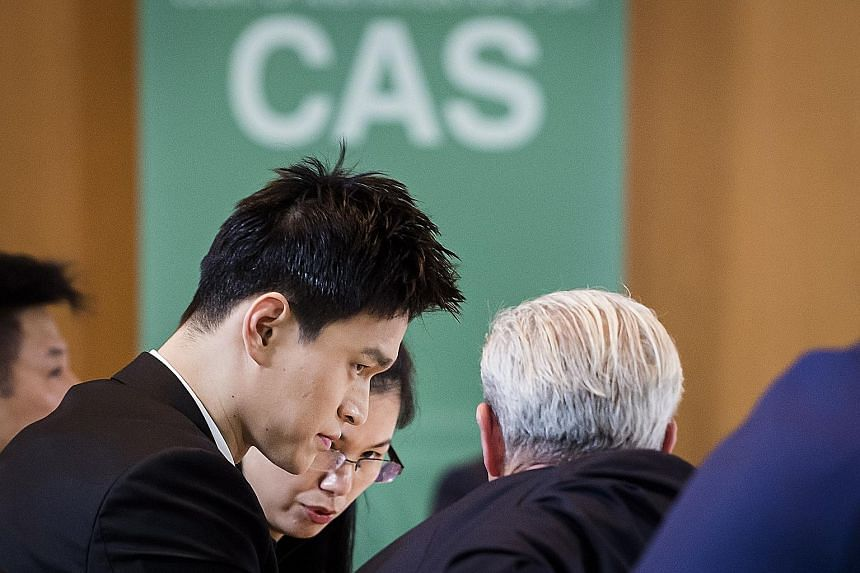 Chinese swim star Sun Yang listening to his lawyers during the Court of Arbitration for Sport hearing into a doping appeal by the World Anti-Doping Agency in Montreux yesterday.