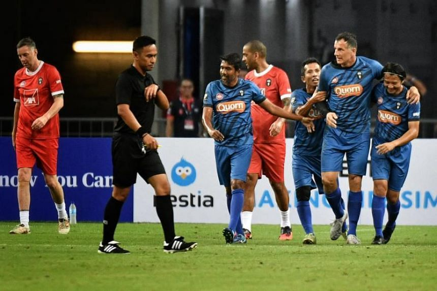 Singapore Reds celebrate Aleksandar Duric's (second from right) goal during the Battle of the Reds match against Liverpool Reds at the National Stadium on Nov 16, 2019.