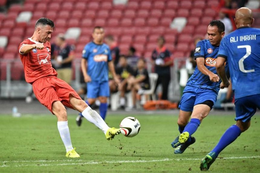 Liverpool Reds' Luis Garcia attempts a shot during the Battle of the Reds match against Singapore Reds at the National Stadium on Nov 16, 2019.